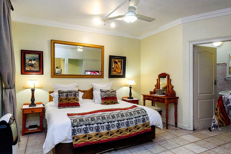 cama King size o dos camas individuales con cuarto de baño.