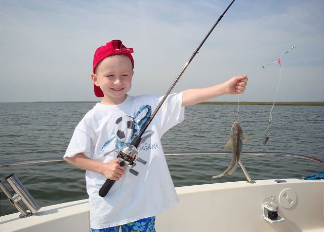 My son Robby when he caught his first fish on North Beach