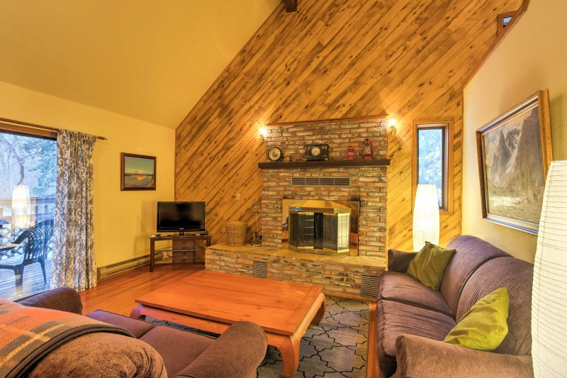 Boasting 2,500 square feet, this home features 2 cozy living areas with brick fireplaces.