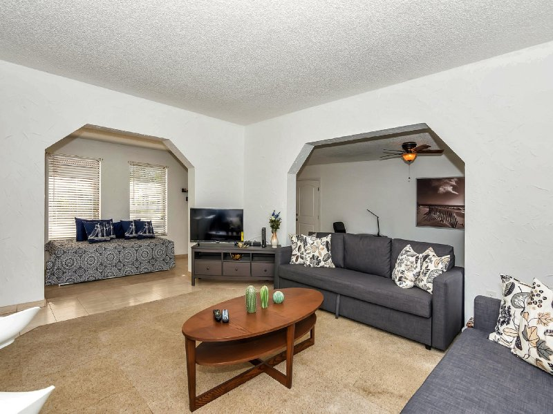 Spacious living room features comfortable sofa beds & daybeds to sleep more guests