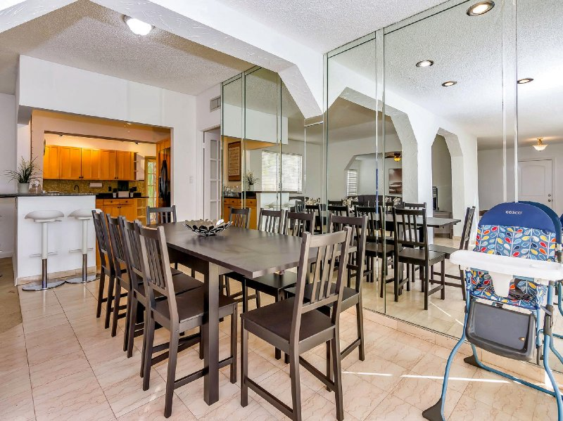 Dining table seats 10 but can accommodate more with the extra chairs.
