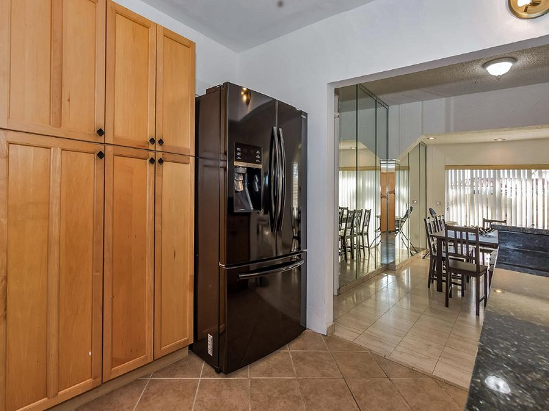 There is a fully functional and considerably equipped kitchen with a full-sized ref, coffee maker.