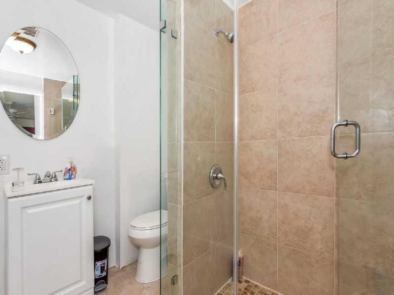 The en-suite full bathroom with shower & toilet. Essentials like toilet paper, shampoo, conditioner.