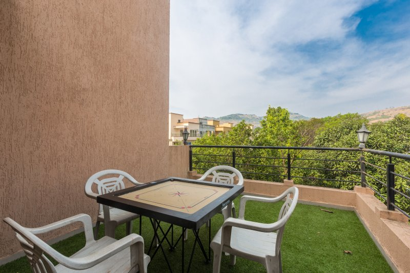 Enjoy the view from the terrace and have fun playing carrom