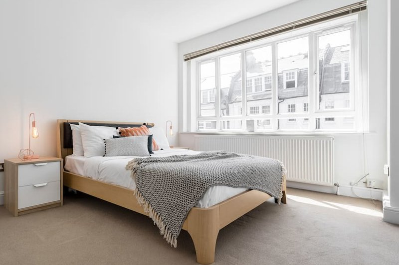 Lovely vast bedroom with with full windows