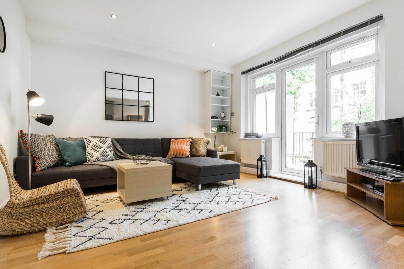 Bright open living room with balcony access
