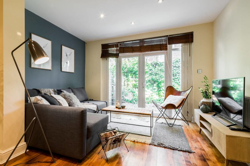 Bright and cosy living room with garden access