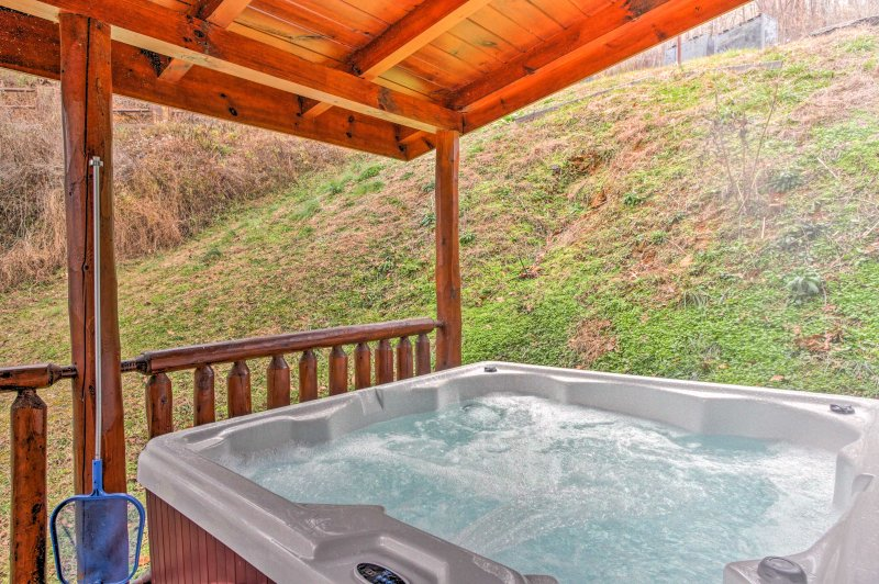 Visit Gatlinburg and stay at this 4-bedroom, 4.5-bathroom vacation rental cabin!