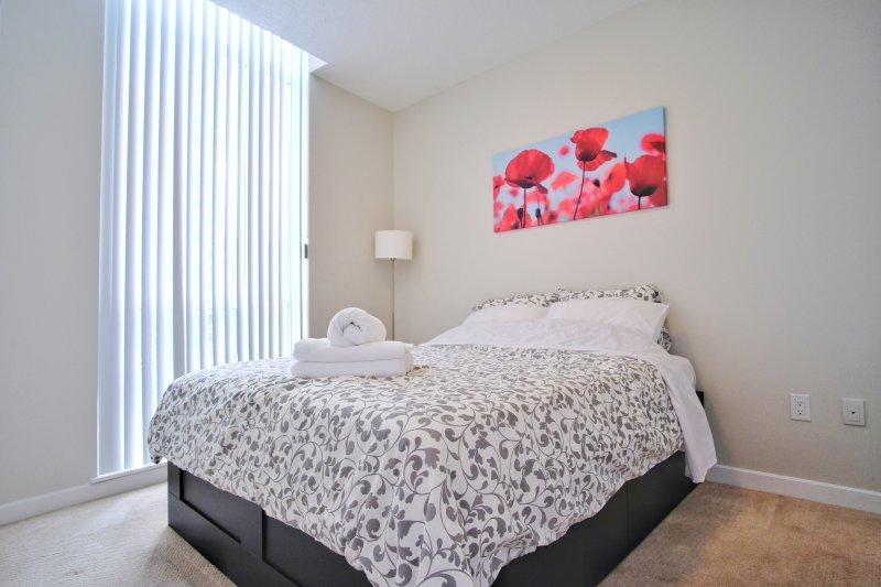 quarto principal confortável e acolhedor.