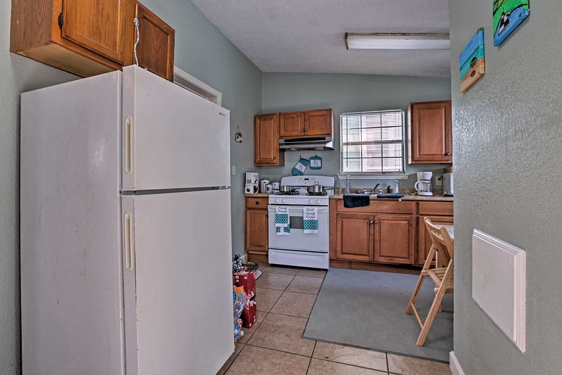 Find modern appliances in the well-equipped kitchen.