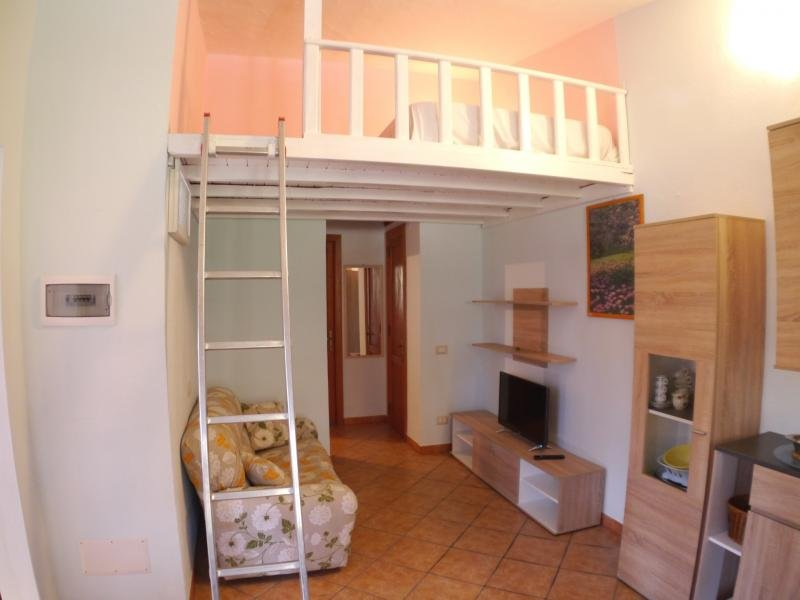 Living area and loft with sleeping space for two people
