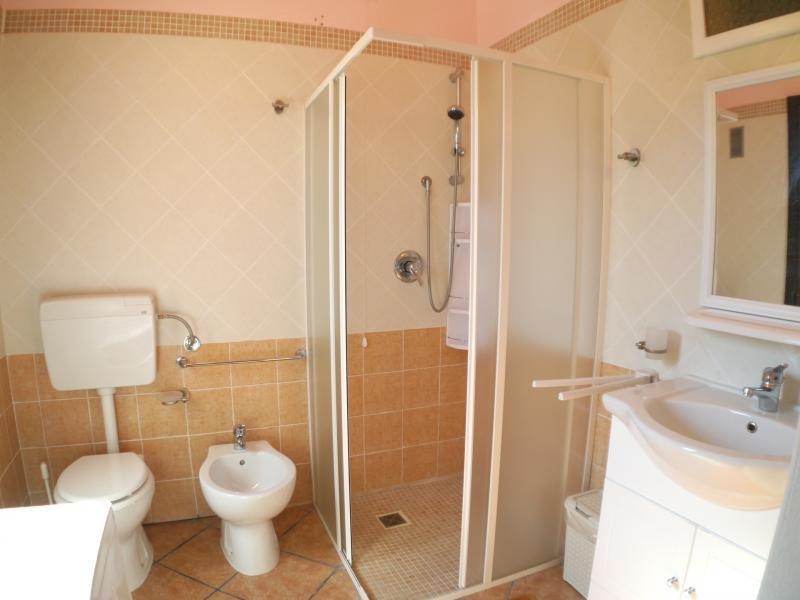 Bathroom with shower bidet and washing machine