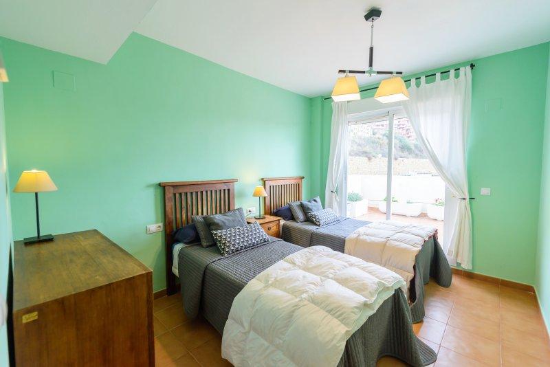Een andere charmante slaapkamer.