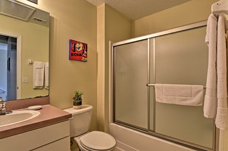 Utilize the shower/tub combo and single vanity found in the second full bathroom.