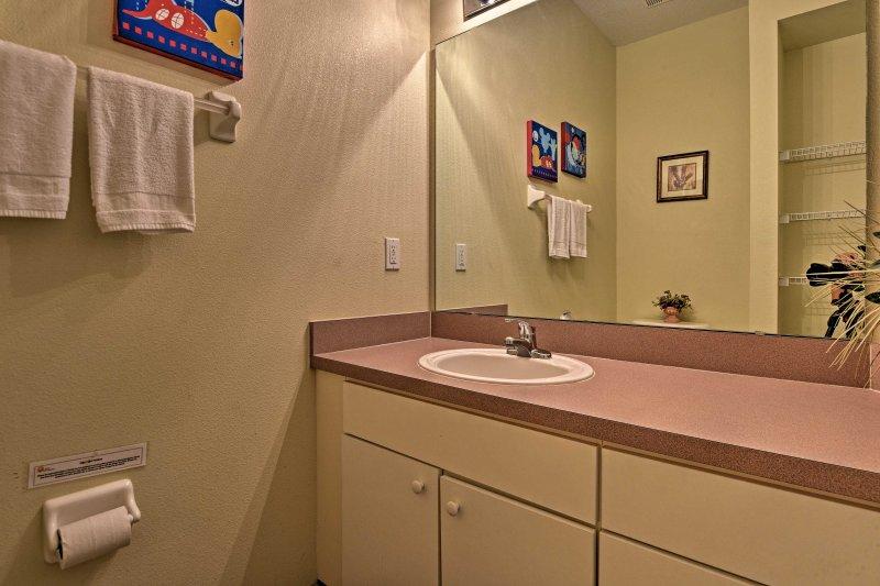 This home features 2 full baths, as well as a half-bath downstairs.