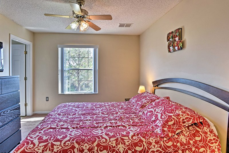 The master bedroom is equipped with a flat-screen cable TV and en-suite bathroom.