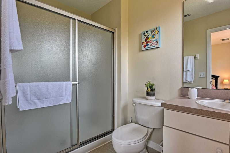 Wash up in the master en-suite, equipped with a walk-in shower and single vanity.