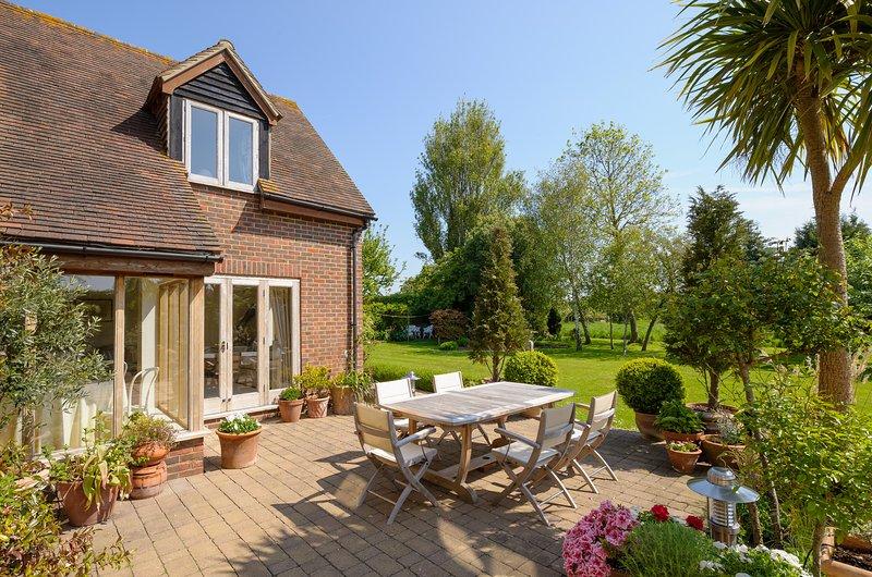 Patio doors opening onto terrace and garden