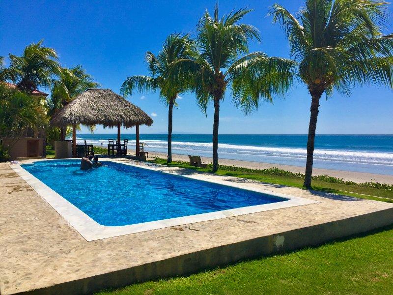 Private Beachfront Condo in Hacienda Iguana, vacation rental in Tola