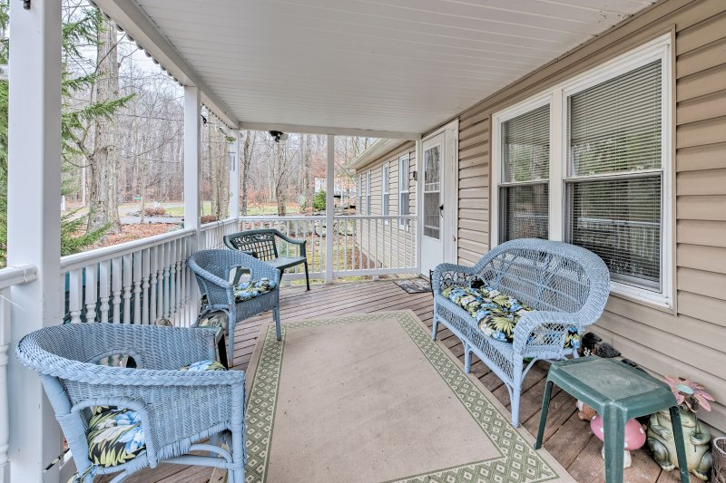 Have a relaxing mountain getaway at this Pocono Lake vacation rental house.