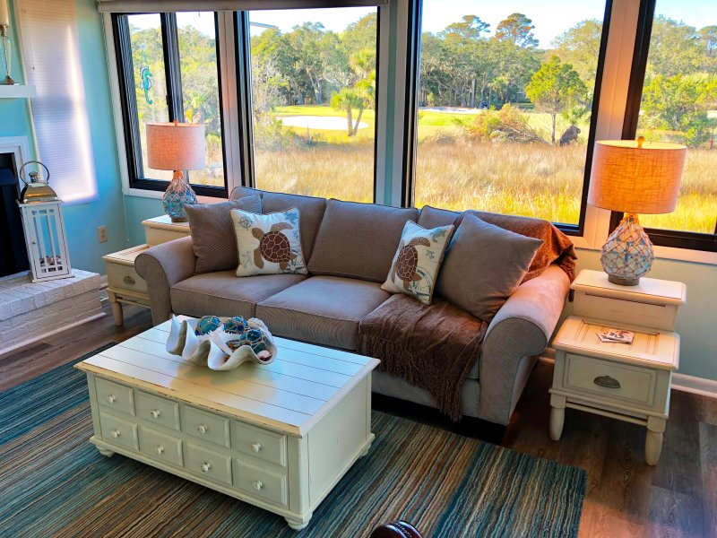 The living room is well appointed with pretty coastal decor.