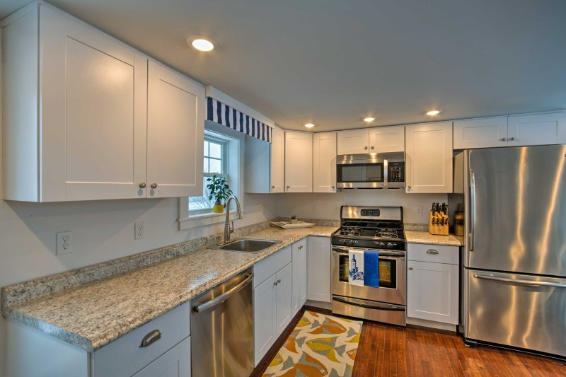 The new stainless steel appliances and sleek recessed lighting are sure to enhance your cooking experience.