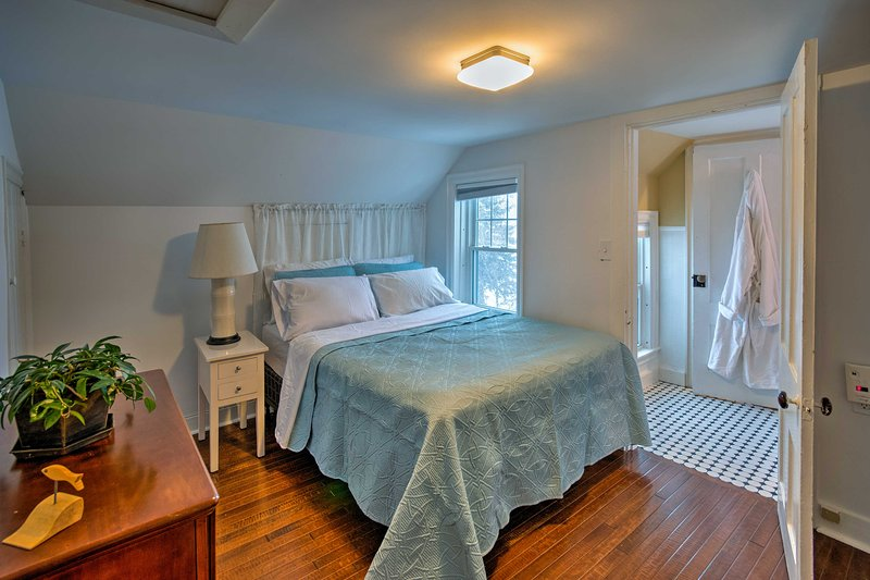 Two travelers will sleep well in this second bedroom with a full-sized bed.