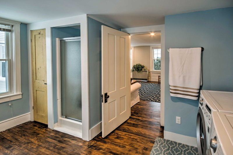 This downstairs full bathroom features a walk-in shower.