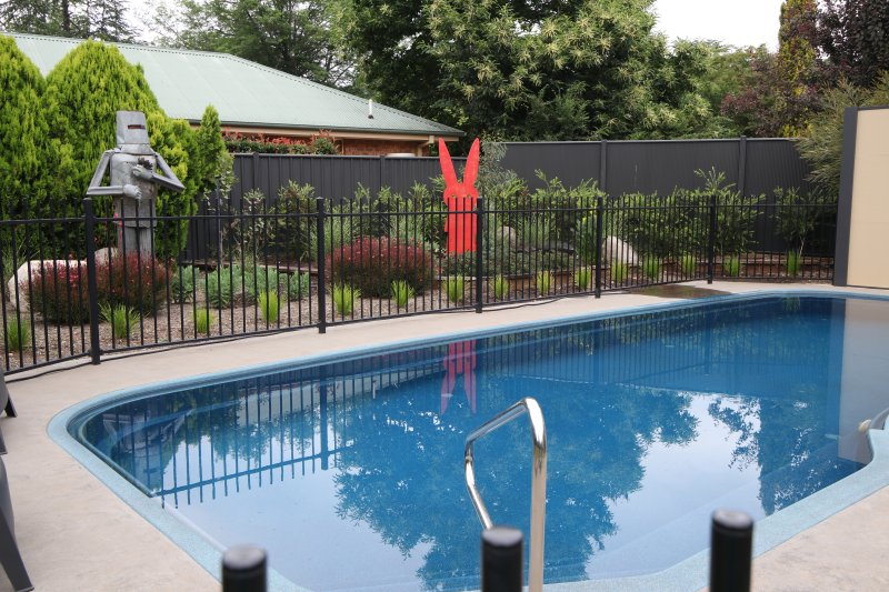 Private large saltwater pool in a beautifully landscaped garden