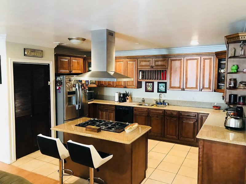 Large kitchen - pantry, island stove, pots, pans, plates, utensils included
