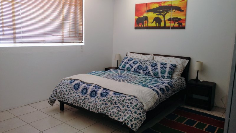 spacious bedroom with Queen sized bed and 100% cotton sheets