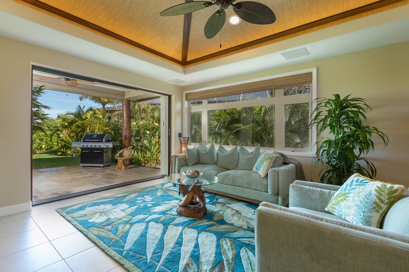 The welcoming living space opens to a covered lanai.