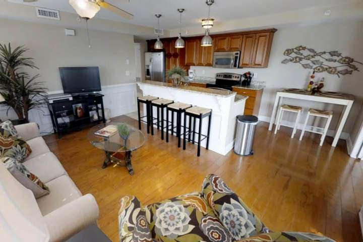 Living area includes ample seating for relaxing and dining.
