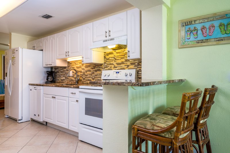 Kitchen has Fridge with water/ice dispenser, dishwasher and snack bar