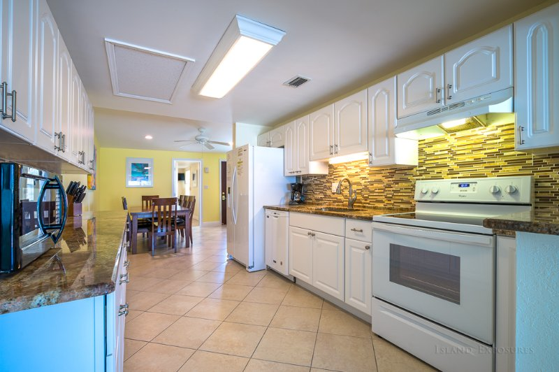 Fridge has water/ice dispenser, dishwasher, stove/oven, microwave and fully stocked kitchen