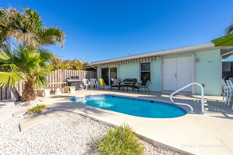 Pool, with table for 6 w/umbrella, table for 4 next to gas grill. 20x10 retractable awning