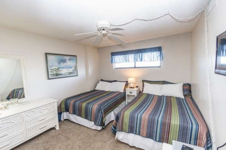 Two double beds and TV in the second bedroom, bath is just across the hall.