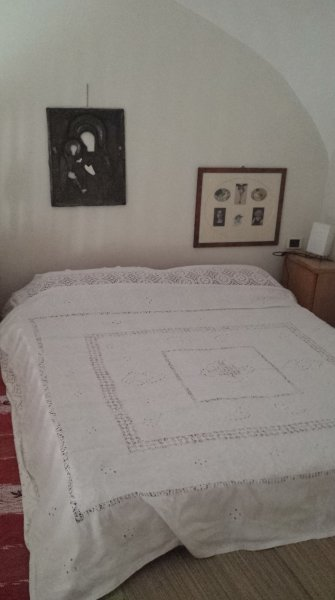 bedroom with hand-embroidered linen