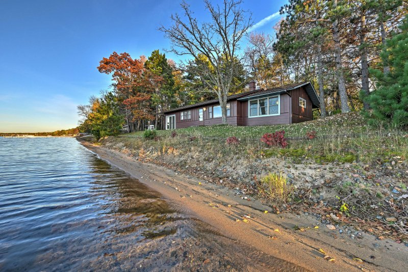 A lakeside getaway awaits at this Merrifield 3-bedroom, 2-bathroom vacation rental house!