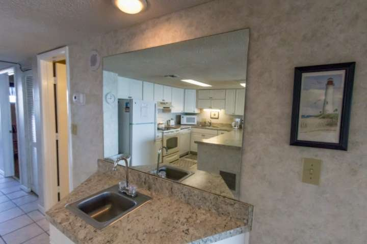 Separate sink and counter area for easy access snacks and drinks