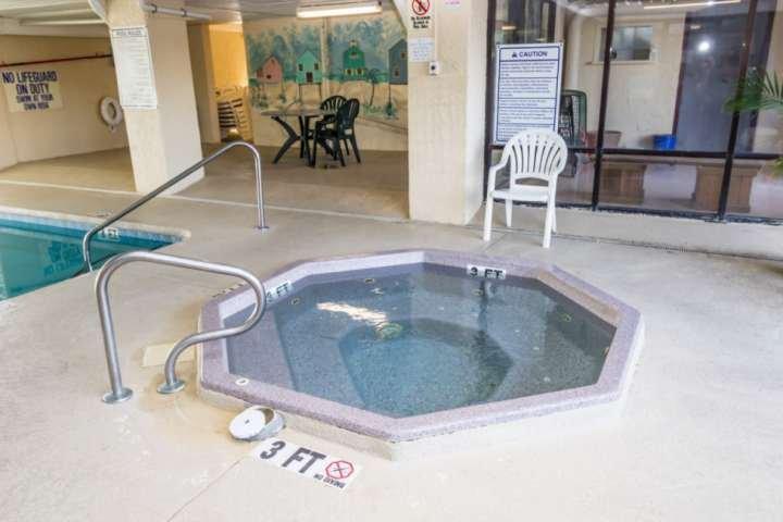 Enjoy the indoor hot tub year 'round, rain or shine.