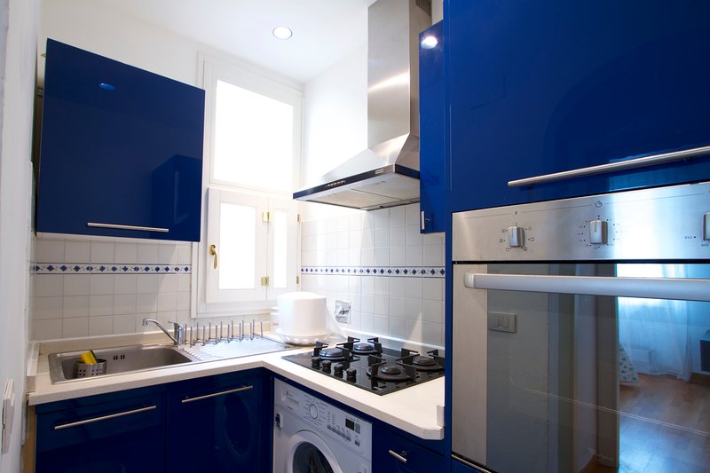 fitted kitchen with washing machine