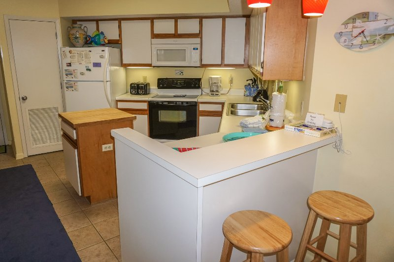 Fully stocked kitchen with all appliances.