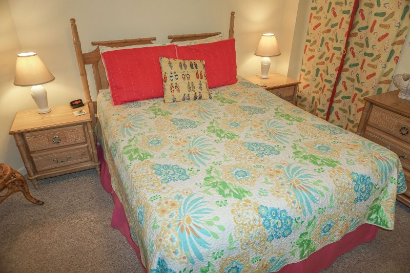 Queen bed in the 3rd bedroom with north facing window.