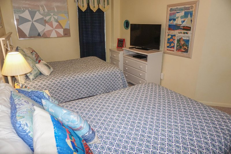Two double beds in the 2nd bedroom with north facing window.