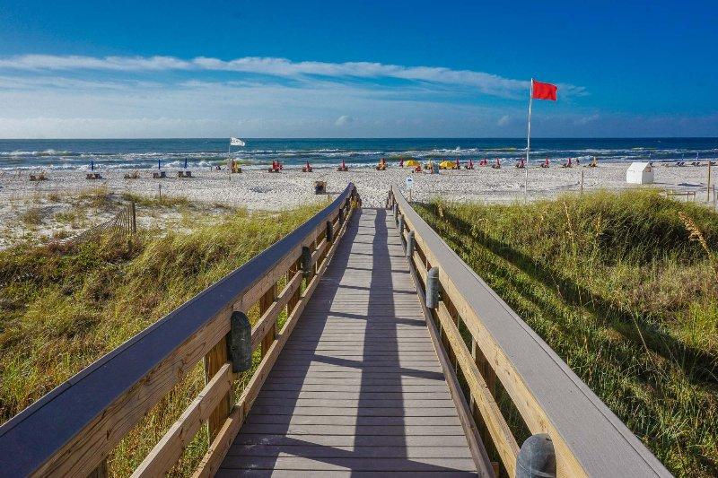 Brand new boardwalk is a few shorts steps to the sandy beach.