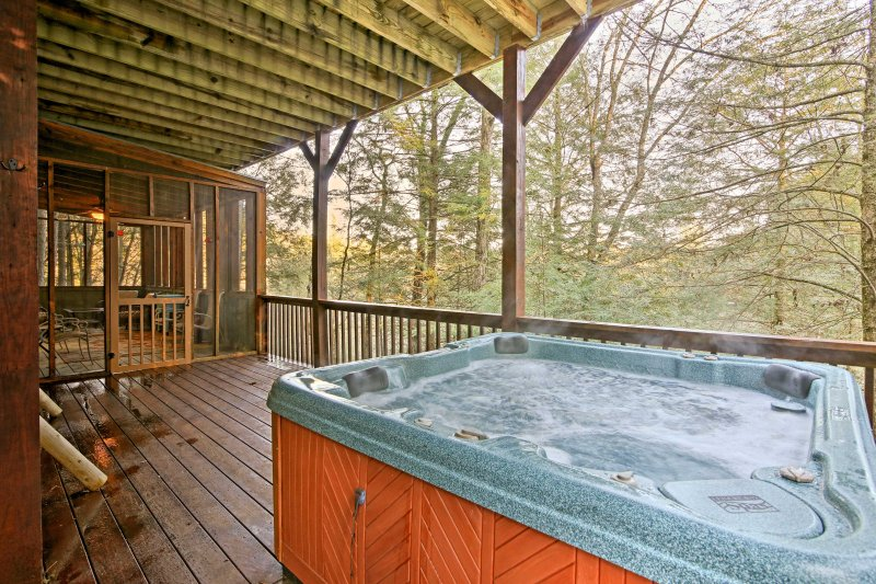 Unwind in the private hot tub while looking out to  picturesque views!