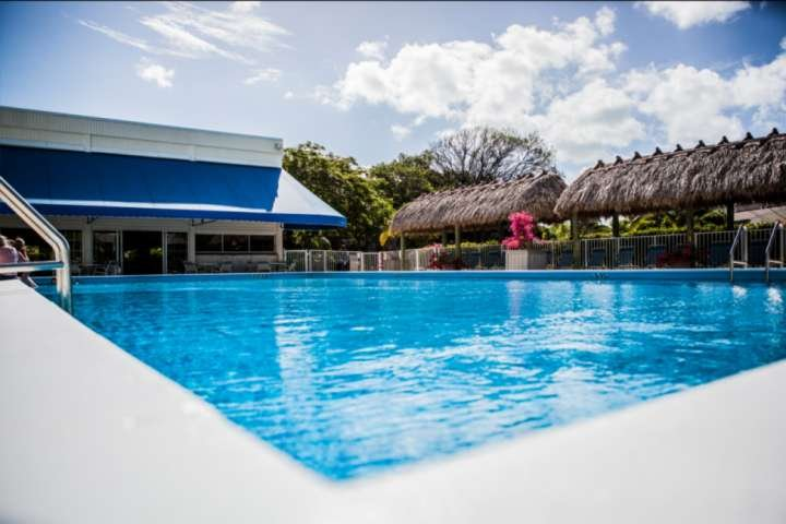 Community pool and sun deck area at Executive Bay.