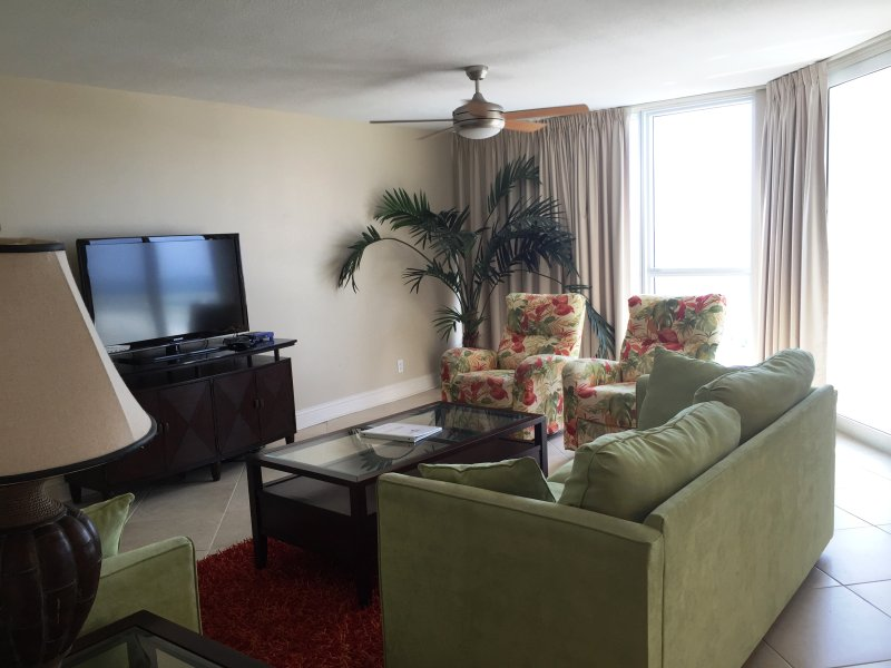 Living Room with sleeper sofa, 2 recliners and Balcony access