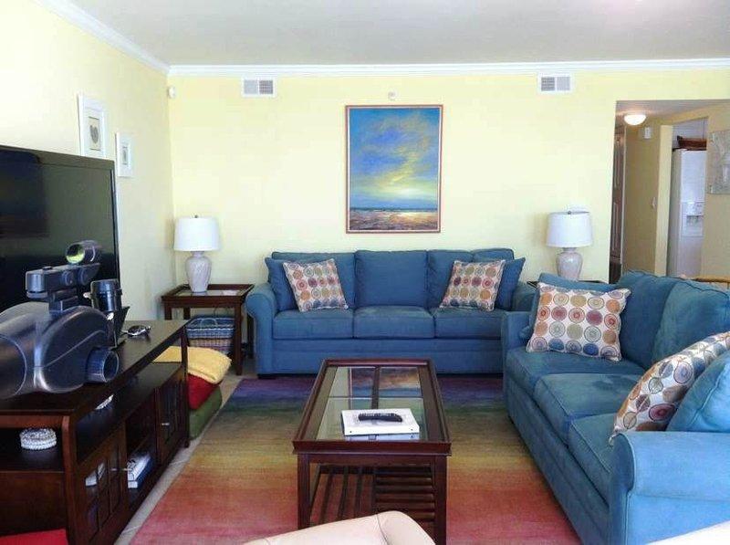 Living Room with sleeper sofa and Balcony access